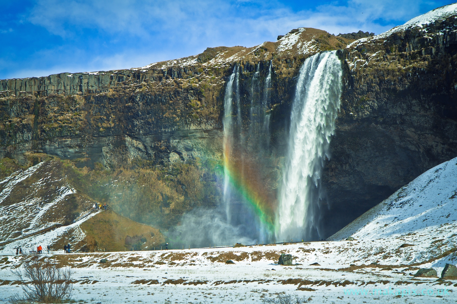 Winter, Rainbow and snow Seljalandsfoss Waterfalls