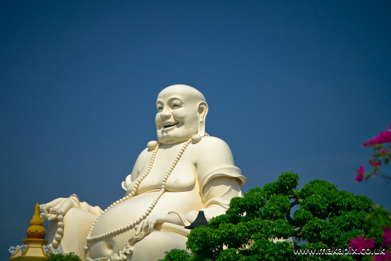 Statue of Budai, Vinh Trang temple, Vietnam